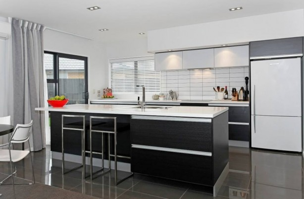 Black and white kitchen with floor and wall tiles